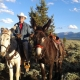 Man riding mammoth donkeys in utah